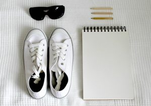 A list, sneakers, and sunglasses.