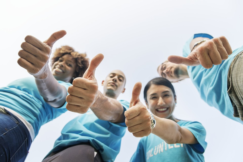 A group of professional movers showing thumbs up before they help you find out how to organize a short notice move.