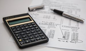 A calculator and financial paper.