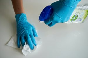 hands with gloves on cleaning