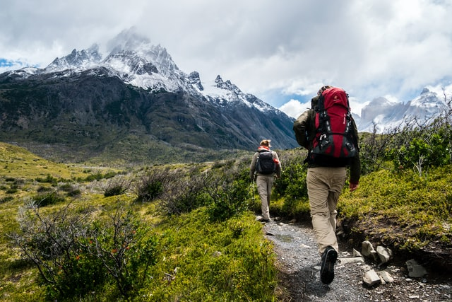 Two persons hiking in the mountains
